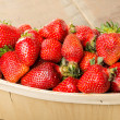 Freshly picked strawberries in a basket — Stock Photo