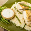 Halibut with asparagus risotto on green plate — Stock Photo #26859851