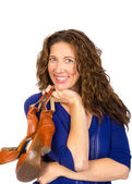 Attractive middle aged woman in blue blouse with shoes — Stock Photo