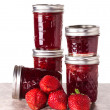 Stock Photo: Fresh strawberries preserved in jars