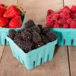 Boxes of fresh berries just picked at market — Stock Photo #27472633