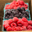 Wooden box with baskets of berries — Stock Photo #28177015