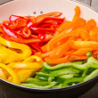 fresh slices of bell peppers in different colors — Stock Photo