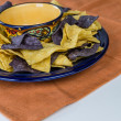 Plate of organic nacho corn chips — Stock Photo