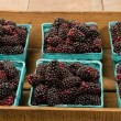 Wooden box with baskets of Marionberries — Foto Stock