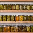 Storage shelves with canned food — Stock Photo #30012055
