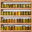 Storage shelves with canned food — Stock Photo #30012081