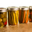 Preserved vegetables in mason jars — Stock Photo