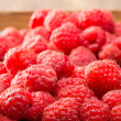 Fresh red raspberries on display at the market — Stock Photo