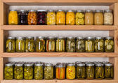 Storage shelves with canned food — Stock Photo