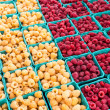 Red and yellow raspberries in boxes — Stock Photo #32774689