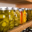 Storage shelves with canned goods — Stock Photo #33721083