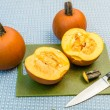 Stock Photo: Pumpkins cut in half to extract seeds