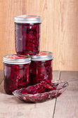 Pickled beets in jars and bowl — Stock Photo