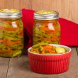 Hot pepper slices canned in mason jars — Stock Photo