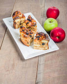 Baked apple bread pudding on white plate — Stock Photo