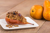 Baked bosc pear with crumble topping — Stock Photo