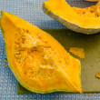 Blue Hubbard squash being prepared — Stock Photo