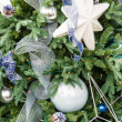 Christmas tree decorated with blue and white — Stock Photo