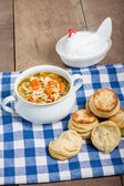 Chicken soup and biscuits on table — Stock Photo