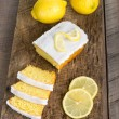 Sliced lemon pound cake with white icing — Stock Photo