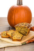 Pumplin walnut bread on cutting board — Stock Photo