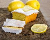 Sliced lemon pound cake with white icing — Stock Photo