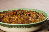 Baked sweet potato casserole with pecan topping — Stock Photo