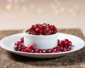 Bowl of cranberry sauce with cranberries — Stock Photo