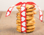 Valentine's Day cookies tied up with heart ribbon — Stok fotoğraf