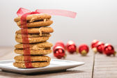 Stack of Christmas Cookies tied with red ribbon — Stock Photo