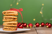Stack of Christmas Cookies tied with red ribbon — Stockfoto