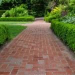 Brick pathways through a garden — Stock Photo #48015493