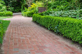 Brick pathways through a garden — Zdjęcie stockowe
