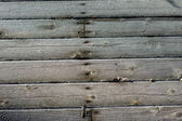 Frost crystals on wooden siding — Stock Photo
