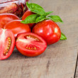 Fresh red paste tomatoes with jar — Stock Photo #50912607