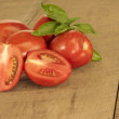 Fresh red paste tomatoes on a table faded — Stock Photo #50912617