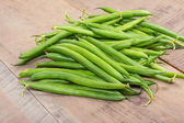 Fresh green beans on table — ストック写真