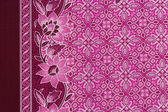 Beautiful pink batik patterns that become traditional clothes ma — Stock Photo