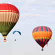 Stock Photo: PUTRAJAYA, MALAYSIA-MAR 16: Hot Air balloon and paraglider in fl