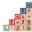 Childrens Alphabet Blocks spelling the word Learn — Stock Photo