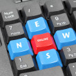 Royalty-Free Stock Photo: Online news word on black keyboard, red and blue button