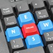 Stock Photo: Online news word on black keyboard, red and blue button
