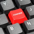 Confirm word on red and black keyboard button — Foto Stock #18496649
