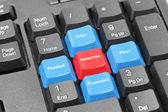Four elements of marketing plan on blue, red and black keyboard — Stockfoto