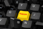 Warning word on yellow and black keyboard button — Stock Photo
