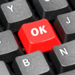 Stock Photo: Ok acronym word on red and black keyboard button