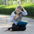 Young asian muslim girl surprised with laptop — Stock Photo
