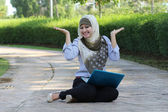 Beautiful young Muslim girl happy emotion with laptop — Stock Photo
