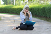 Young asian muslim girl happy with laptop — Stock Photo